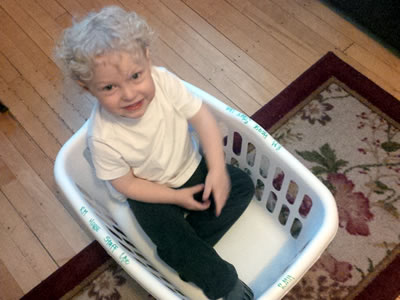 Gabe Steinwand in a laundry basket