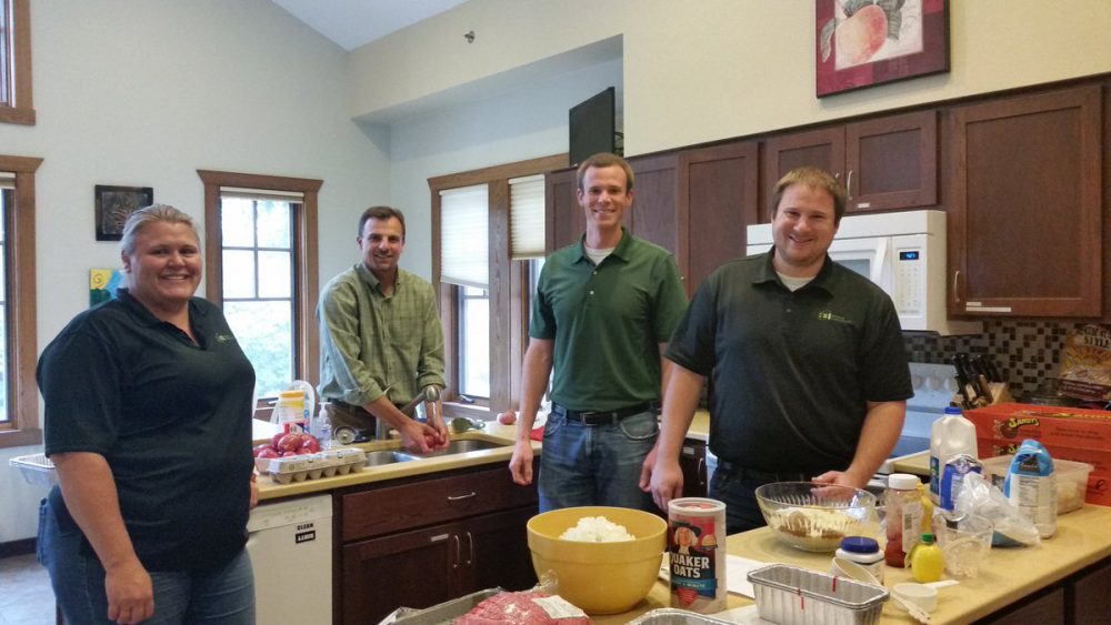 Photo of four volunteers in kitchen