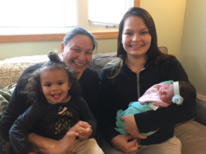 Family of four with one toddler and one baby girl