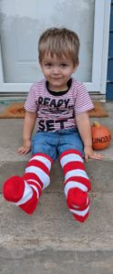 Two year old Lincoln wearing stripes socks